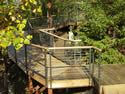 Wooded view of black aluminum wood handrail cable railing system